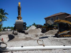 Demucking and site preparation for new construction